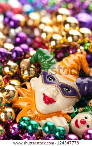 Vertical of Colorful, Plastic Mardi Gras Beads with Court Jester and Space for Copy or Text