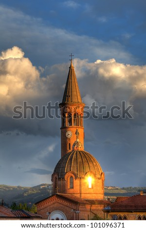 Vertical oriented image of Madonna Moretta catholic church at sunset in Alba, Northern Italy.