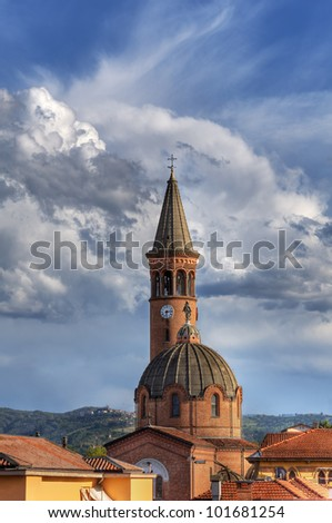Vertical oriented image of Madonna Moretta catholic church under beautiful sky in Alba, Northern Italy. - stock photo