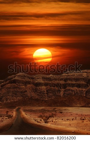 Vertical oriented image of sunset over the mountains of Arava desert in Israel.