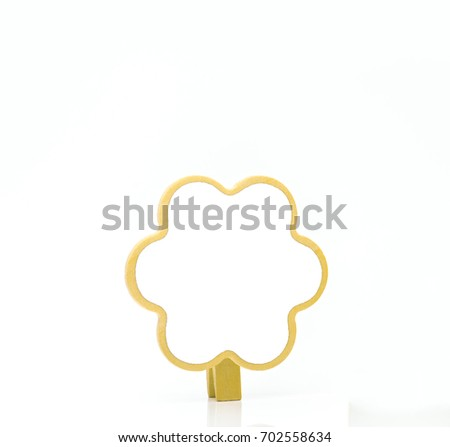 Vertical paper clip made of wood with copy space on white background #702558634