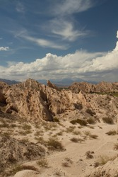 Vertical photo. Arid landscape. Geology. View of the dry valley, sandstone and rocky hills.