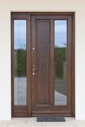 Vertical photo of a wooden entrance door