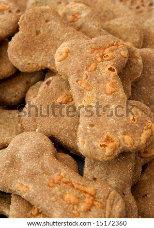 Vertical photo of gourmet dog biscuits in shape of bones from specialty baker on sale at local market