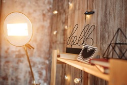 Vertical photo of stylish loft design decorations. Studio apartment. Industrial. Grunge wall texture.