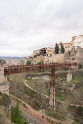 Vertical photography of Hanged Houses (Casas Colgadas) and San Pablo bridge in Cuenca, Spain.