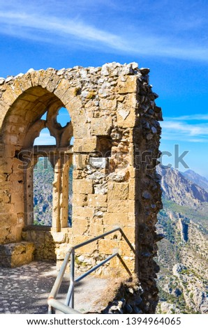 Vertical photography of the ancient ruins of St. Hilarion Castle in Northern Cyprus. The view point offers an amazing view of Cypriot Kyrenia region and Mediterranean. Popular tourist spot.