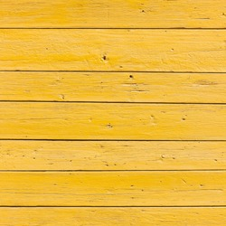 vertical picture of old horizontal planks with bright yellow paint