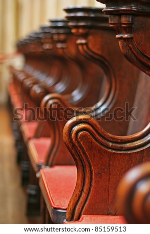 Vertical picture of rows of wooden church pews