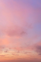 Vertical picture of sky in the pink and blue colors. effect of light pastel colored of sunset clouds.