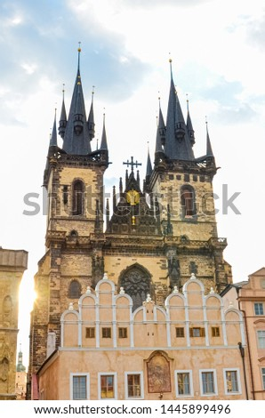 Vertical picture of The Church of Our Lady before Tyn in Prague, Czech Republic. Beautiful sunrise light, against the sun. Gothic church and a dominant of the Old Town Square. Amazing cities.