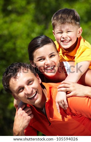 Vertical portrait of a playful smiling family