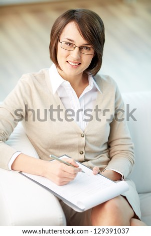 Vertical portrait of a successful psychologist or a businesswoman