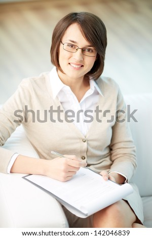 Vertical portrait of a successful psychologist or a businesswoman