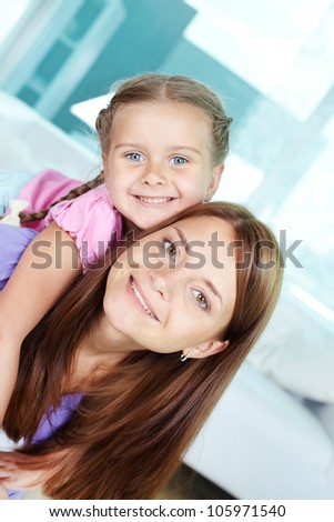 Vertical portrait of mother and daughter hanging out together