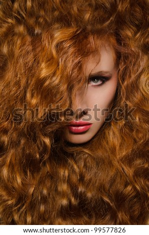 Vertical portrait of young woman with red hair