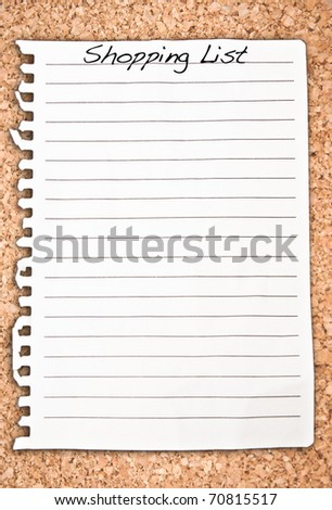 Vertical shopping list on cork background