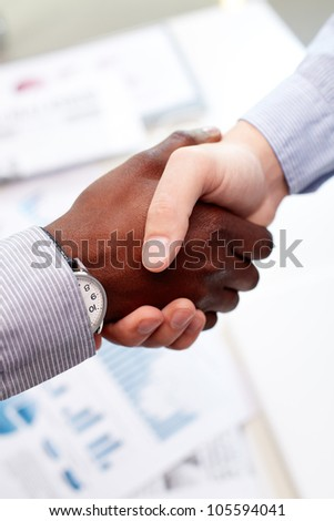 Vertical shot of a firm business handshake guaranteeing safety and evoking trust