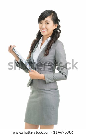 Vertical shot of a girl holding a clipboard with financial data