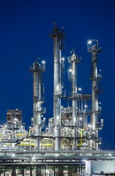 Vertical shot of an oil refinery with night blue sky.