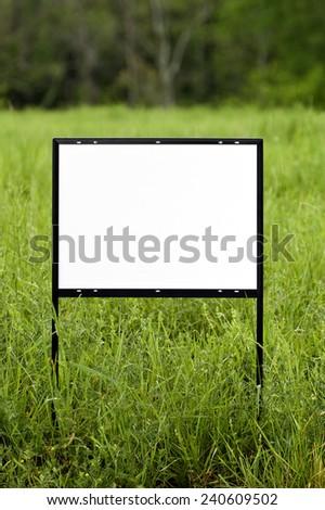 Vertical Shot Of Blank Real Estate Sign