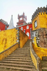 Vertical shot of Pena Palace located in Sintra near Lisbon Portugal, big stairs on foreground