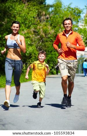 Vertical shot of three cheerful runners