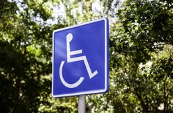 Vertical sign for disabled people, detail of information sign, facilities for people