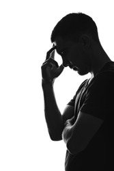 vertical Silhouette portrait profile of thinking young man holding his hand to his forehead, pose of thinker