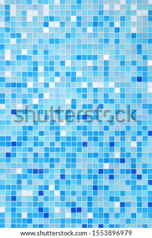 Vertical small blue tiled wall background with gradient #1553896979