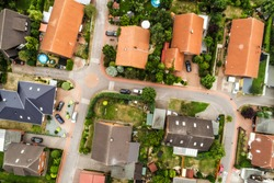 Vertical view from the air with vertical view of houses, roofs and streets of a village in northern Germany.