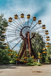 Vertical view of an abandoned ferris wheel in the decaying amusement park of Pripyat, Ukraine inside the Chernobyl Exclusion Zone