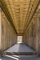 Vertical view of long empty gallery corridor of the Neue Nationalgalerie (New National Gallery). Portico with columns in perspective, in the Museum Island, Berlin, Germany
