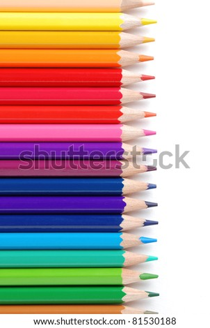 Vertical view of row of colored pencils, isolated on a white background