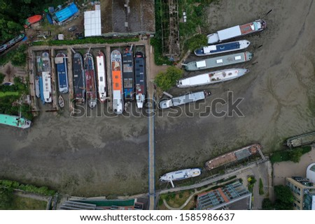 Vertical View of Several Ships Parked on the Ground in London