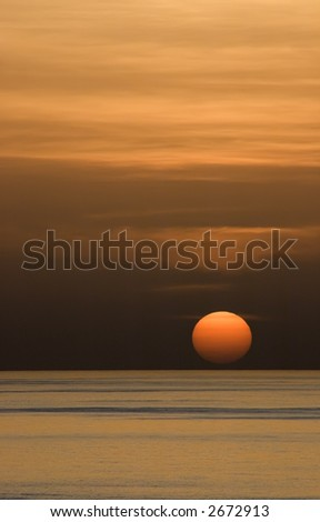 ocean water sunset. stock photo : Vertical view of sunset over ocean water filtered by hazy