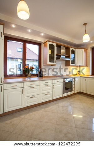 Vertical view of the beige kitchen