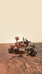 Vertical wallpaper of rover on Mars surface. Exploration of red planet. Space station expedition. Perseverance. Expedition of Curiosity. Elements of this image furnished by NASA