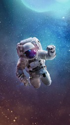 Vertical wallpaper with astronaut in outer bright space with stars and galaxies. Elements of this image furnished by NASA