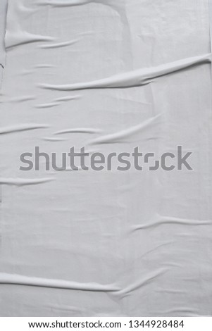vertical white empty crinkled paste up street poster surface