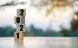 Vertical wooden cubes have numbers 2021, the start of the new year.
