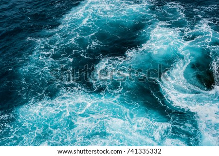 vertiginous, swirling foamy water waves at the ocean photographed from above #741335332