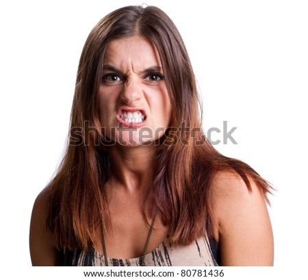 Very agressive young woman bares her teeth at the camera