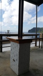 Very artful wooden table fixed with iron pillar and nice views