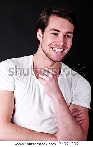 very attractive smiling man on a black background