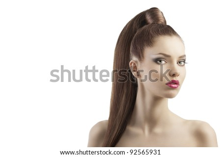 very attractive young brunette with long hair and tail and creative hair style looking luxory and proud, she looks in to the lens and her mouth is slightly open