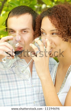 Very attractive young couple enjoying a glass of wine outdoors