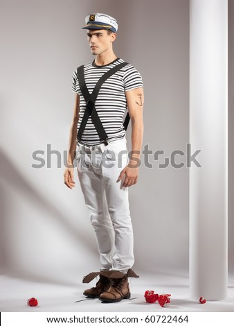 very attractive young man model dressed like a sailor - full body studio shoot - stock photo