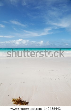 very beautiful blue ocean and white sand background with on the horizon dark clouds