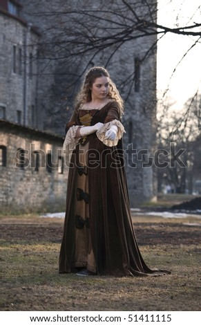 Very beautiful girl in medieval dress in Old Tallinn